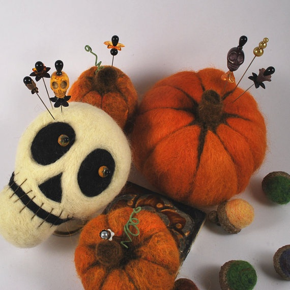 Large soft sculpture pumpkin with decorative purple skull pin 0001