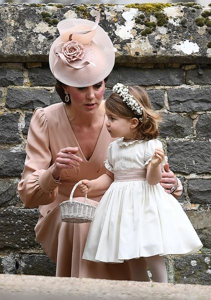 Kate Middleton Photos Photos - Britain's Catherine, Duchess of Cambridge (L) stands with her daughter Britain's princess Charlotte, a bridesmaid, following the wedding of her sister Pippa Middleton to James Matthews at St Mark's Church in Englefield, west of London, on May 20, 2017.