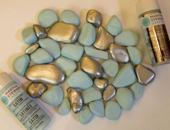 painted rocks - why did I never think of this? Rocks from the dollar tree painted to match any decor. Put them in a glass container with a candle.