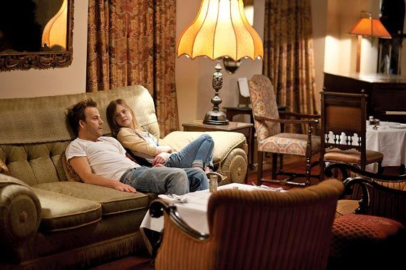 FILM / Stephen Dorff and Elle Fanning lounge on a living room couch filming Sofia Coppola's Somewhere. [2010] #film