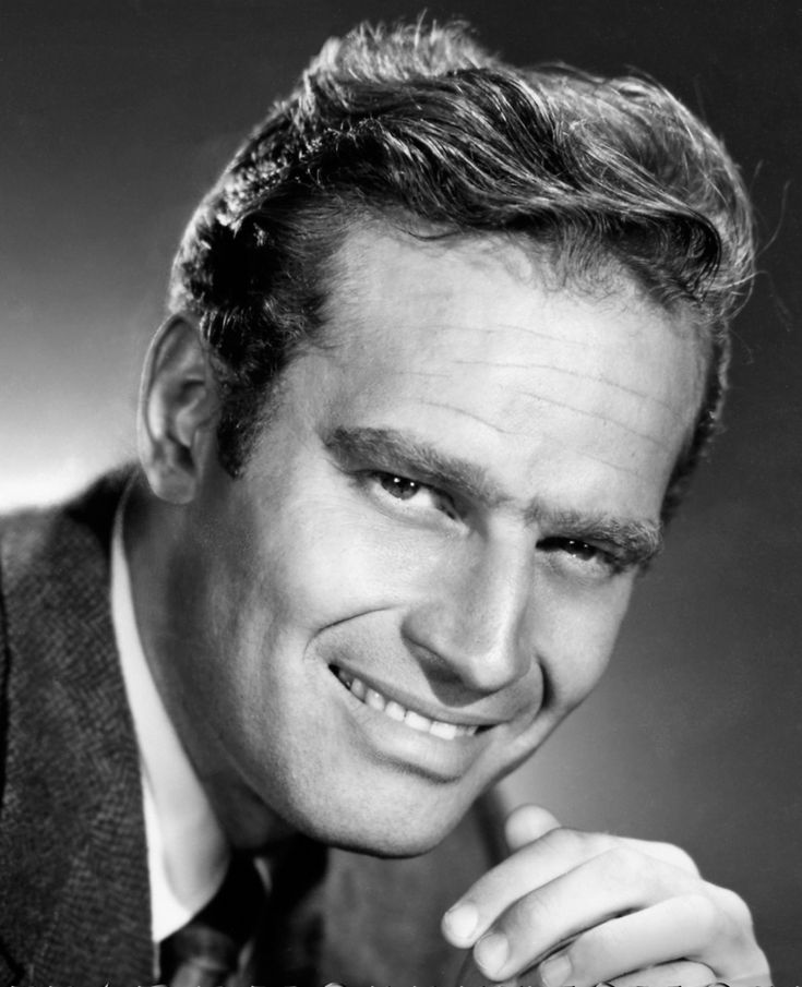 CHARLTON HESTON. Ben and I were standing next to him on a buffet line at a post-opening party one night in L.A. I passed on the ham.