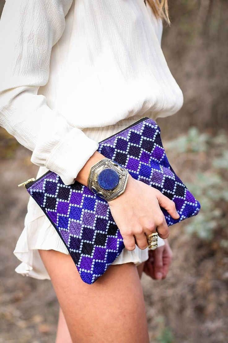 Who needs pants when your clutch is this fabulous! And that bracelet!