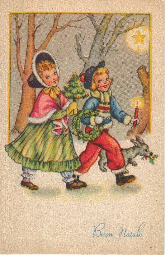 Due bimbi con cagnolino recano ornamenti natalizi