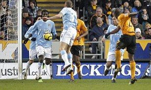 Hull City 2 Man City 1 in Feb 2010 at Eastlands. George Boateng fires Hull's 2nd goal through a crowded Man City penalty area #Prem