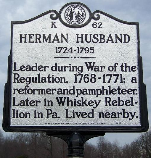 Historical marker in Randolph County, NC, commemorating Herman Husband's role in the War of the Regulation.