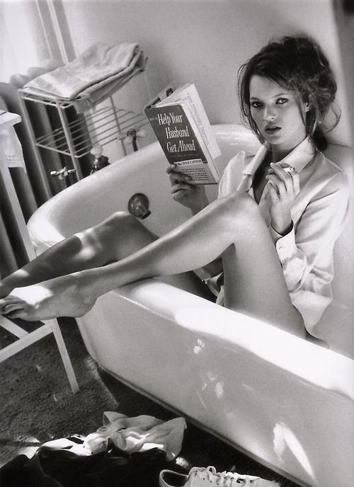 Kate Moss reads. In an empty bathtub.. Photo by Sante D'Orazio for Vogue Italia December 1995