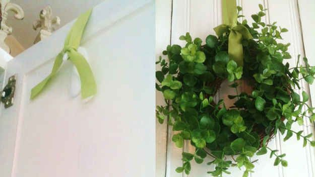 You can also use Command hooks to hang wreaths seamlessly over a door. | 38 Clever Christmas Hacks That Will Make Your Life Easier