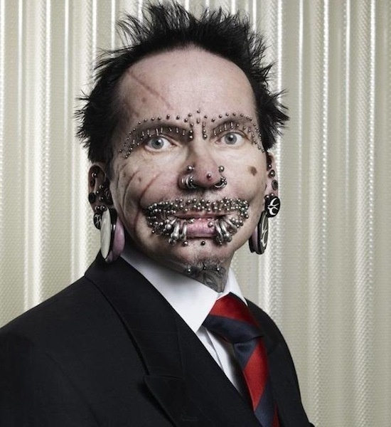 Most Pierced Man - Rolf Buchholz of Dortmund, Germany has 453 studs & rings throughout his body.