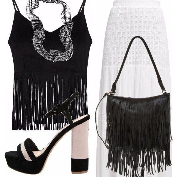 Un look casual per questo outfit, composto da gonna lunga bianca, top nero con frange, sandali con tacco black e white, borsa nera con frange. Per un tocco chic ho abbinato la collana in acciaio Breil.