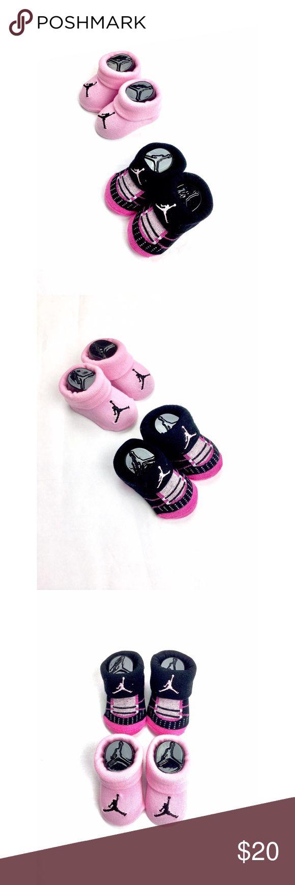 Infant Girl Jordan Socks Two Pair Set Cute infant baby girl Jordan socks.  One pair is pink with black logo and second pair is black with pink logo.  NWOT. Never worn. Jordan Accessories Socks & Tights