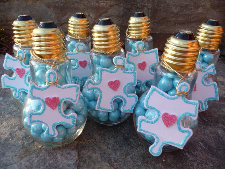 April is AUTISM awareness month!!  Made these for Kyra's DREAM TEAM!! (light bulb vases/blue sixlets) Pins made w/blank puzzle craft/blue glitter and red heart stickers)........craft by Erin Mitchell....proud mother of a beautiful child touched by autism! :)