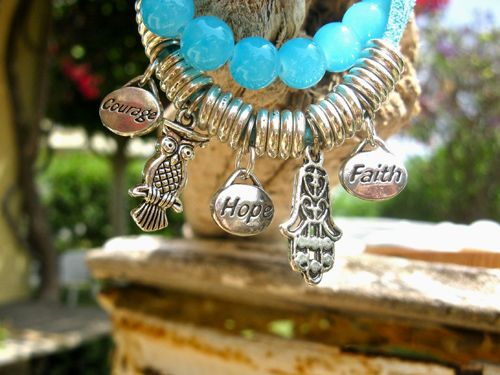 Word charm bracelet with additional charms of an Owl and a Hamsa to reinforce the meaning of this jewellery