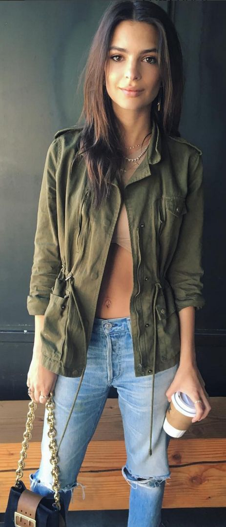 Who made Emily Ratajkowski's green jacket, blue handbag, and ripped jeans?