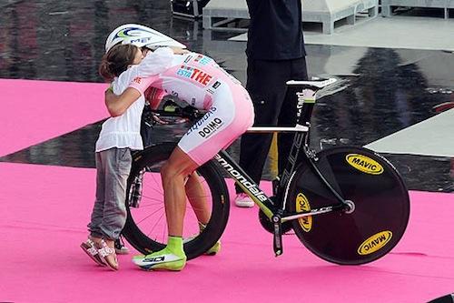 ivan basso - winner of the giro d italia meet his daughter on the podium!