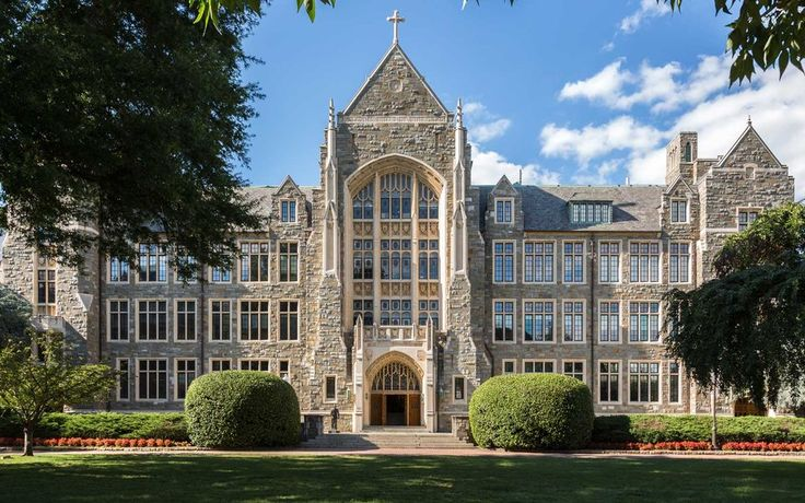 Georgetown University in Washington, D.C.-Grey spires and old brick halls towering on a hill above the Potomac River. Crisply manicured lawns and a prime Washington, D.C. location. Georgetown has been this district's beauty since 1789.