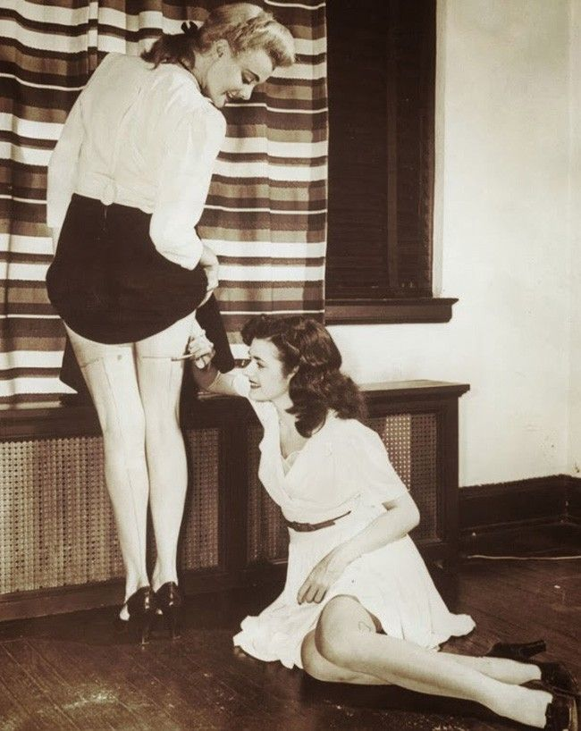 Women painting their legs to make it appear that they were wearing stockings [1942]