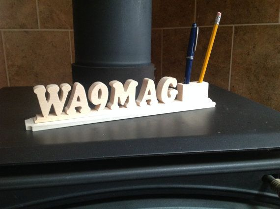 """This is a Ham Radio Call sign made from select pine and unfinished. The measurements are 13"""" L x 2"""" H x 2"""" W and ¾"""" thick. This sign will be sanded smooth ready for a finish. If you would like one made from Red Oak, the price will be $22.00 unfinished. You can make the choice between Pine and Red Oak at the check out. Please include your call sign when you order. All items in my shop are guaranteed. Please check out my shop policies. Thanks for looking"""