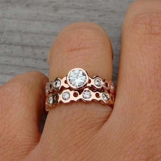 Green wedding rings made from #recycled 14kt gold and moissanite stone (born from a meteorite) Moissanite has been scientifically measured and has 2.4x more fire and 10% more luster than a diamond? I didn't know that!