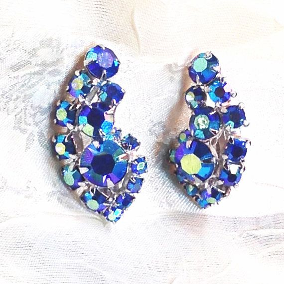 These vintage blue crystal clipon earrings are in a curved paisley or yin-yang shape, but any way you look at them youll be dazzled. How beautiful on the bride! Estate jewelry from the 1930s, simply gorgeous. Possible Carnegie mark on back.