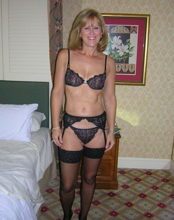 Alluring cougar doing what she does best 4 3