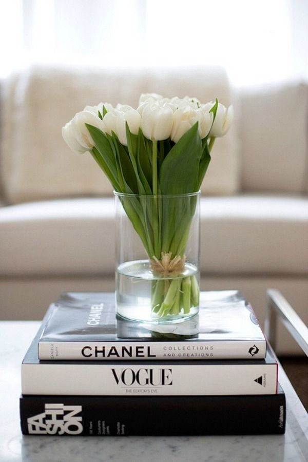 white tulips and coffee table books