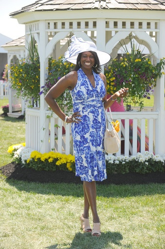 Sandra Bryan-Grier, Comcast operations senior director, tops off her blue and white frock with a blue-trimmed white hat her husband, Kenneth Grier, found at Macys to match the dress at Preakness 2012.