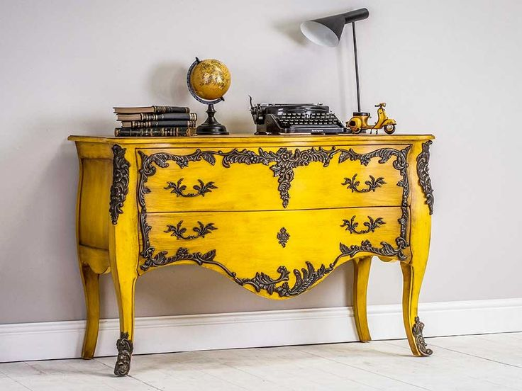 Bold and beautiful chest of drawers with ornate brass detailing