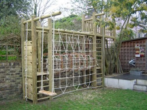 Wooden Climbing frame for small garden - swing, scramble net and wooden tower