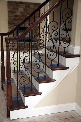 wood and iron staircase design!  visit stonecountyironworks.com for more wrought iron designs!