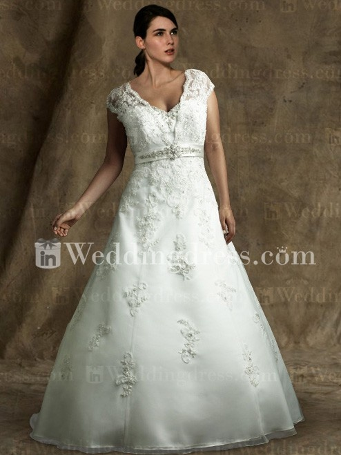 Vintage wedding dress with cap sleeves features in organza.
