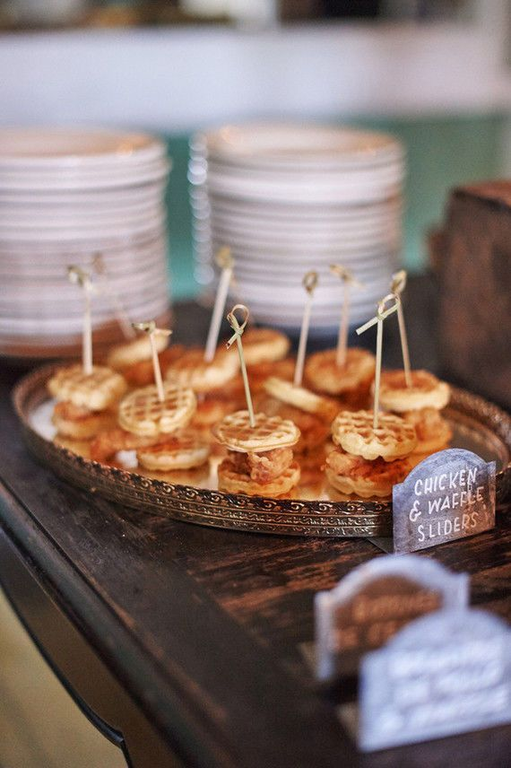 Chicken and Waffles Sliders: In the middle of summer, wedding guests often don't want to eat rich foods, instead preferring lighter fare. But when the seasons have changed, it's time to bust out the more decadent appetizers, like these delish chicken and waffle sliders for a fall wedding reception.