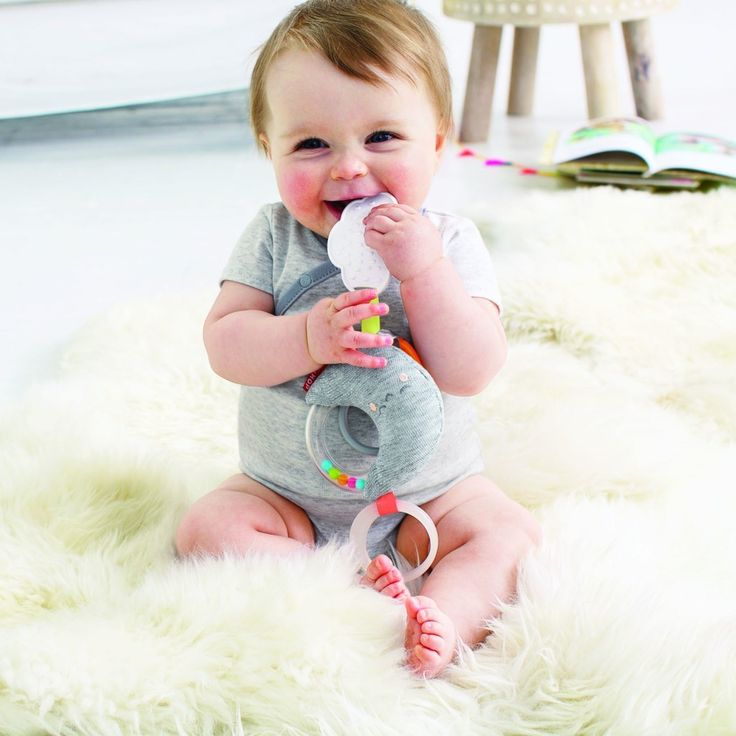 Our sleepy moon friend features neon rattle beads to stimulate baby's auditory and visual senses. With a textured, cloud-shaped teether and sweet embroidered details, it's sure to be one of your little's one go-to baby toys. Like all our stroller toys, it has a built-in loop so you can easily attach it to the bar of your stroller, infant carrier or other gear. Ages 0m+, Plush moon-shaped stroller toy offers on-the-go fun, Neon rattle beads stimulate baby's auditory and visual senses…
