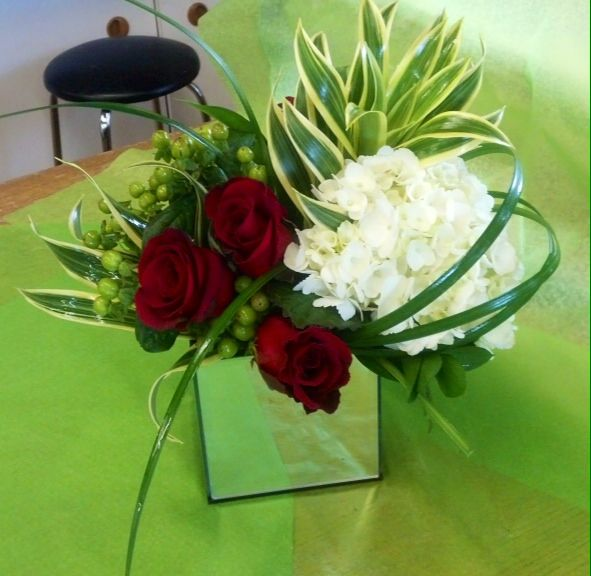 Short centerpiece with red roses and white hydrangea. Toronto/GTA florist