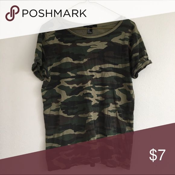Camo Tee Dark Green Camouflage tee by Forever 21. Sleeves are sewn up for a different look than a tee shirt. Bundle this item with 2 or more items from my closet and save another 10% off! Comment below if you have any questions :) Forever 21 Tops Tees - Short Sleeve