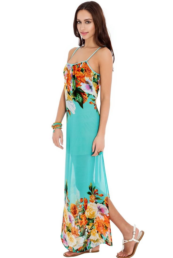 Turquoise and Tropical Floral Print Maxi Sundress. This Loose fit tropical print sundress is perfect for poolside posing. Add gold accessories after dark to take it from day to night. £36.00