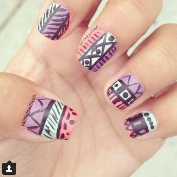 Matte tribal nails.
