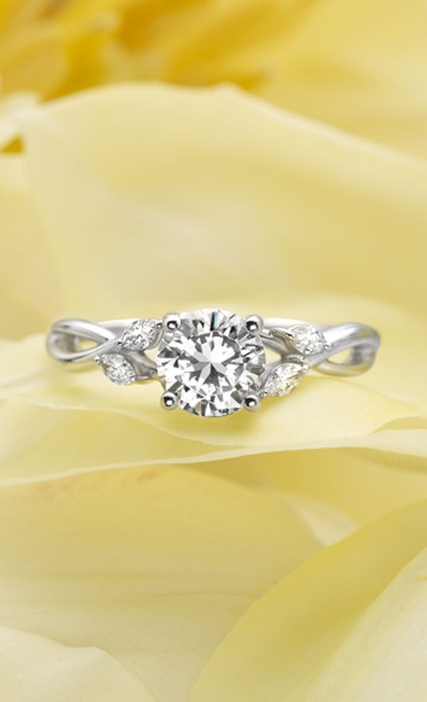 Platinum engagement ring. Looks like leaves on the sides!