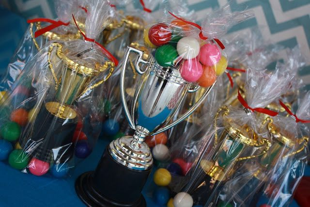 Wipeout Party - My favorite ideas are the gumball filled trophy favors, trampoline boxing, make-your-own-snow cones and simple gumball cake.  -tkz
