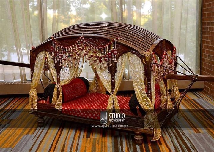 What better way to make an entry (or exit) at your wedding than a doli?!