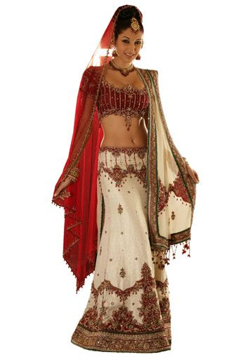 BW77 Maroon & Off White Lehenga PANETAR A panetar with a short maroon silk blouse and a trumpet fit brocade skirt with placement embroidery, teamed with an embroidered off white dupatta and an extra net dupatta.