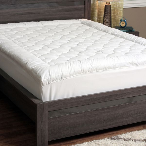 If you've ever dreamt of what it would be like to sleep on a soft fluffy cloud, you'll find out when you sleep on a mattress covered with a CozyClouds by DownLinens Billowy Clouds Mattress Pad. The Billowy Clouds Mattress Pad is made with a thick 300-thread count cover and Gel Fiber Poly fill to give your mattress a soft luxurious layer of comfortable padding.