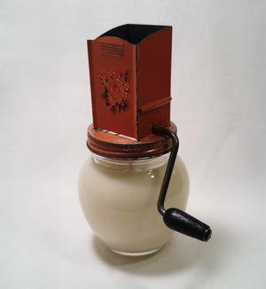 Vintage Orange Nut Grinder made into 100% Soy candle! www.antiquecandleworks.com