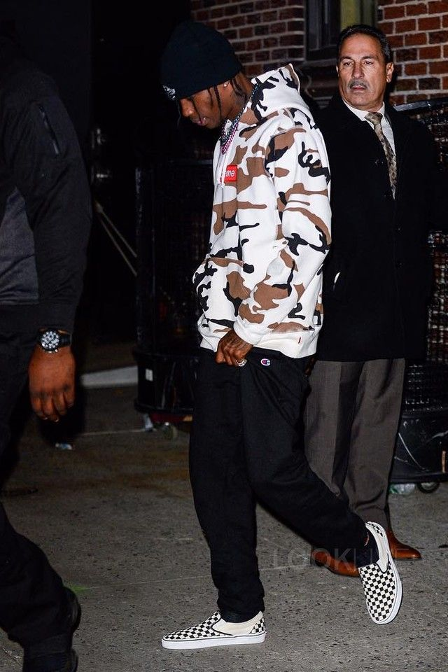 Travis Scott wearing  Supreme Box Logo Hoodie, Champion Powerblend Joggers, Vans Checker Slip On