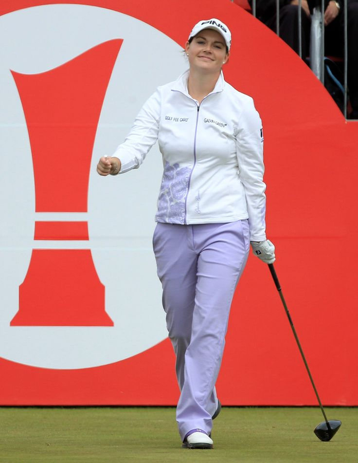 Caroline Masson Photos Photos - Caroline Masson of Germany walks off the 1st tee during the third round of the 2011 Ricoh Women's British Open at Carnoustie on July 30, 2011 in Carnoustie, Scotland. - Ricoh Women's British Open - Day Three