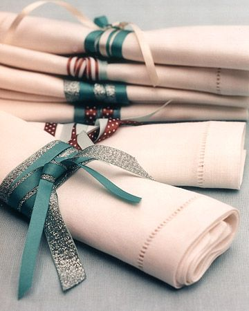 Napkins  Dinner napkins casually tied with aqua and brown ribbons gave place settings a relaxed feel