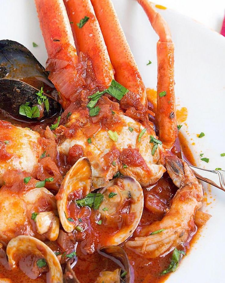... tomato based sauce. Crab, Clams, Mussels, Shrimp and Scallops make up