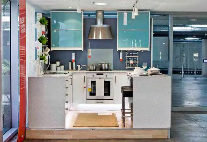 Contemporary IKEA kitchen with metallic silvered blue Resene Shapeshifter on the wall.