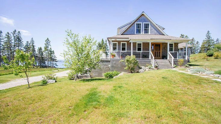 Perched on a spruce-spiked cliff on Vinalhaven's southwestern shore, this gray-shingled home looks like your typical island cottage, but it is so much more. There are wide porches, rich timber-frame ceilings, and windowed gable walls facing the blue and green panorama of Penobscot Bay — a view you can fully appreciate when you have all the feeling in your fingers and toes. Learn more about this modern cottage.   Listing Agent: Terry Sortwell, LandVest - Midcoast, Maine Real Estate