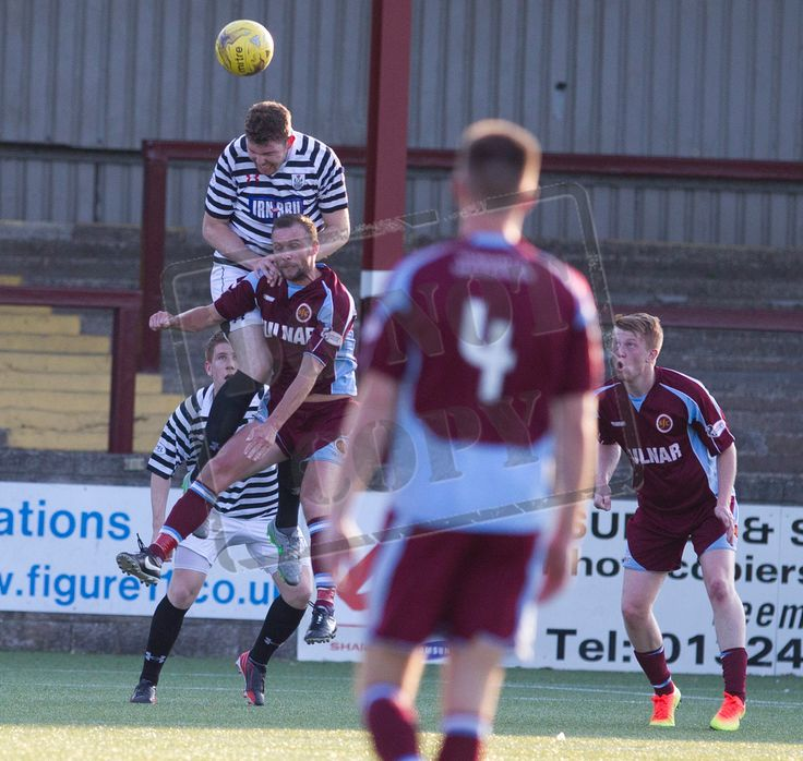 Queen's Park's Ryan McGeever heads the ball clear during the Betfred Cup game between Stenhousemuir and Queen's Park