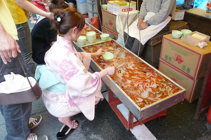Kingyo sukui (goldfish scooping) is a popular game at matsuri. You get to keep the fish, if you can get it into the bowl before your rice paper scoop disintegrates.
